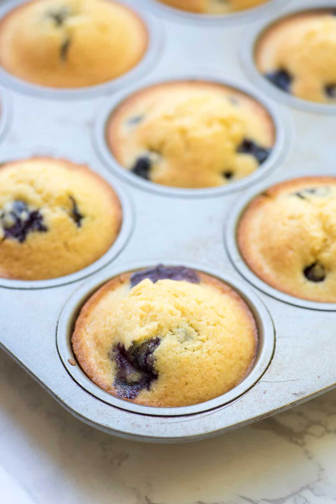 These Blueberry Cornmeal Muffins have a pretty yellow hue and a ...
