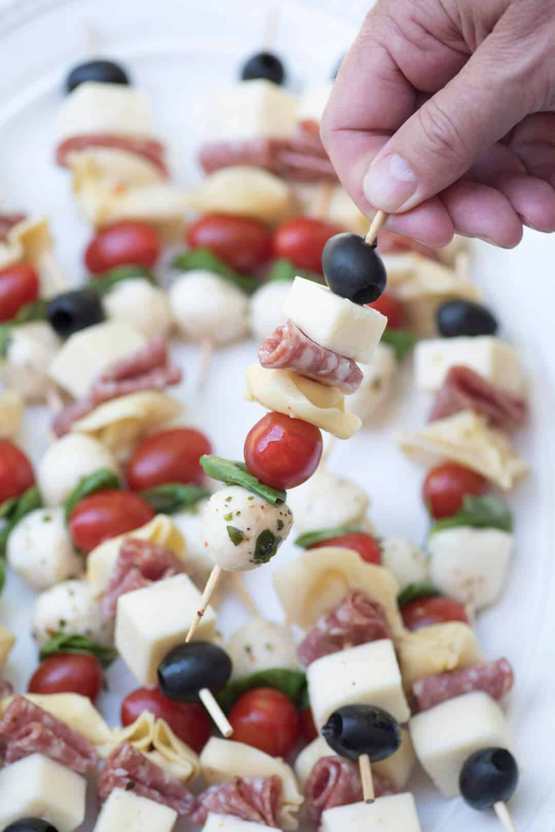 Delicious ingredients all together in one little appetizer skewer. These Antipasto Skewers are a super easy, make-ahead, grab-and-go party snack!