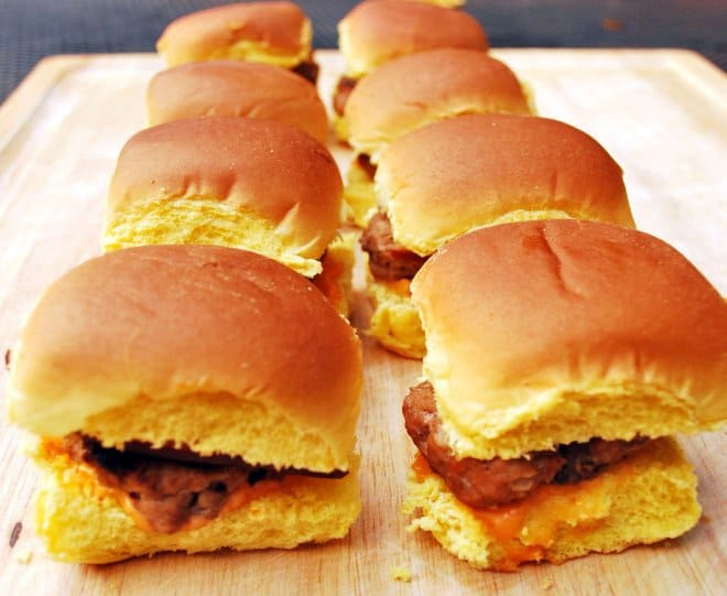 Turkey Burger Sliders lined up on a wooden cutting board.