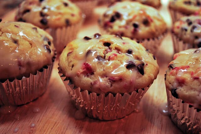 Cranberry Chocolate Chip Muffins on a wooden cutting board.