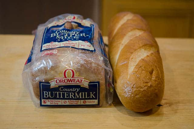 A loaf of Orowheat Country Buttermilk Bread and a sweet French bread.
