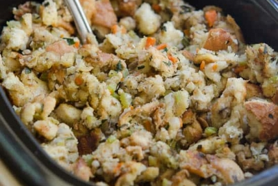 A Crock Pot filled with stuffing.