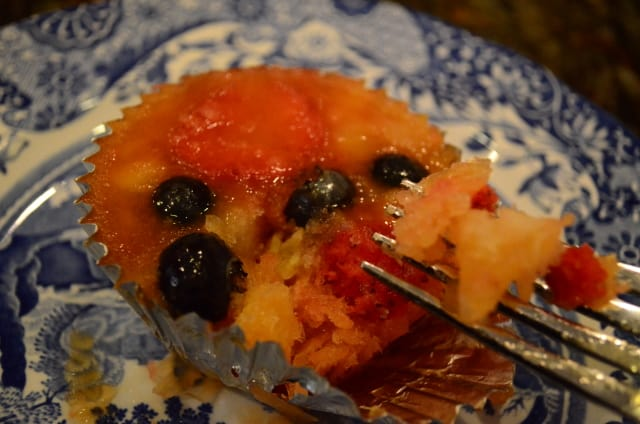 A fork breaks into a Frozen Fruit Salad on a blue serving plate.