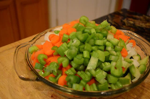A glass dish of the chopped vegetables.