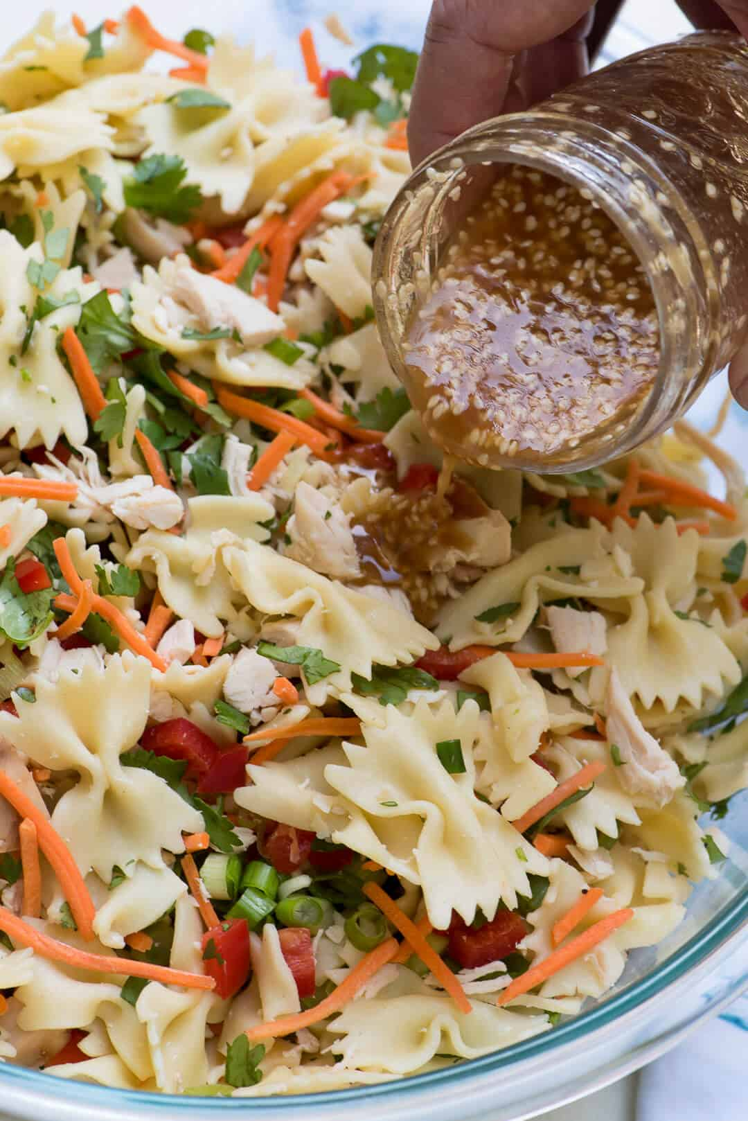 This Asian Pasta Salad has a satisfying crunchy texture and a completely addictive sesame-soy dressing that will have everyone coming back for seconds!