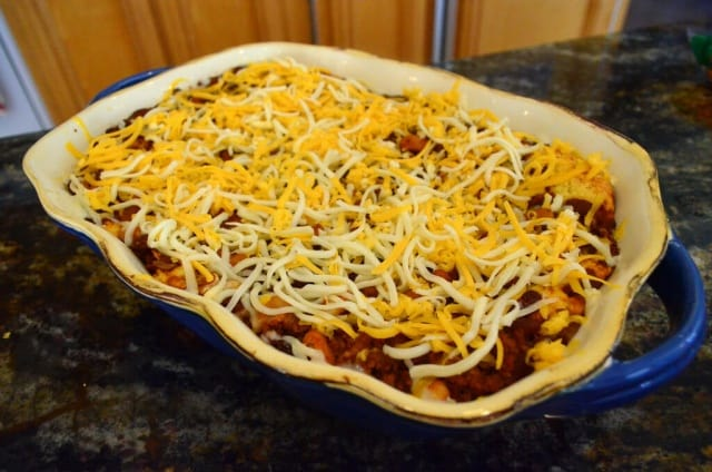 After the initial baking time, the Chili Cornbread Bake is topped with plenty of shredded cheese.