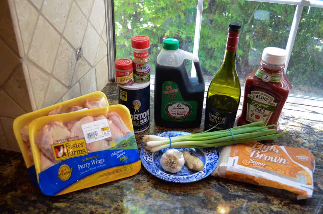 All the ingredients required to make the chicken wings arranged on a counter top.