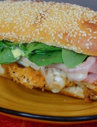 A close up of a chicken cordon bleu sandwich.