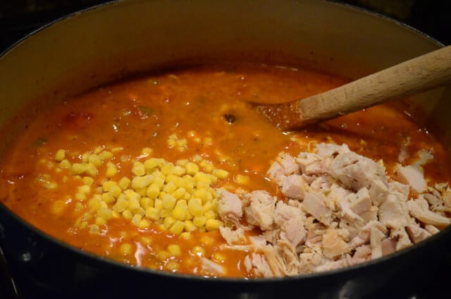 Corn, black beans, and turkey are added into the pot.