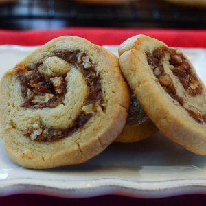 A close up of date pinwheels cookies on a plate.