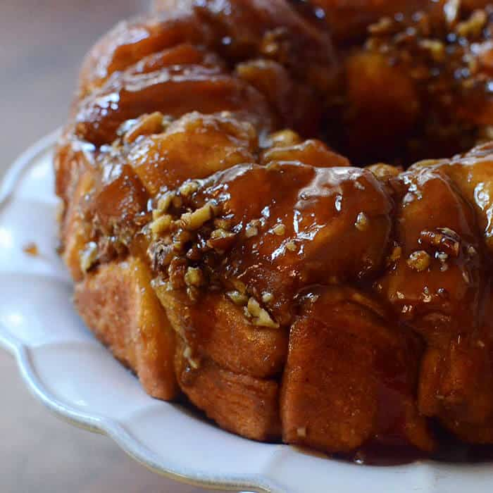 This Easy Maple Pecan Monkey Bread is layered with bite-sized cinnamon and sugar coated biscuit pieces, chopped pecans and has an irresistible maple butter glaze that keeps them coming back for more!