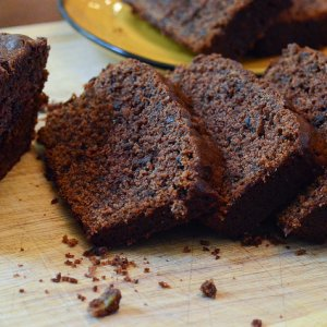 Slices of Chocolate Peanut Butter Banana Bread on a wood board.