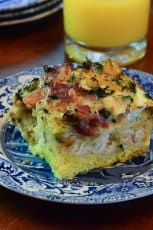 A slice of an egg breakfast bake on a blue plate,