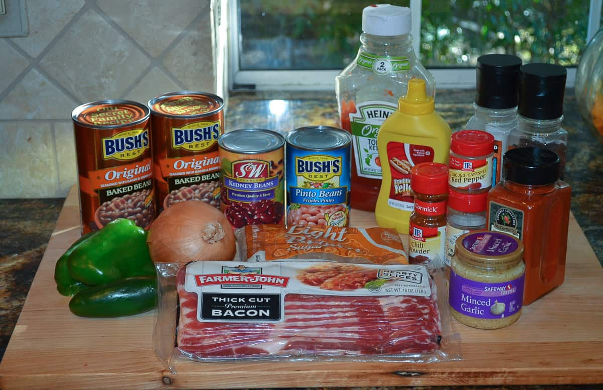 All the ingredients required to make Spicy Baked Beans.