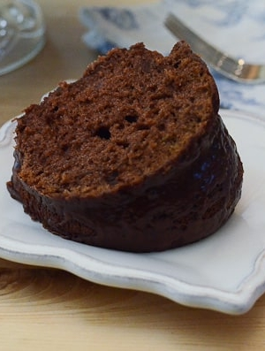 A piece of black russian bundt cake on a white plate.