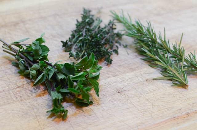 Fresh herbs on a cutting board.