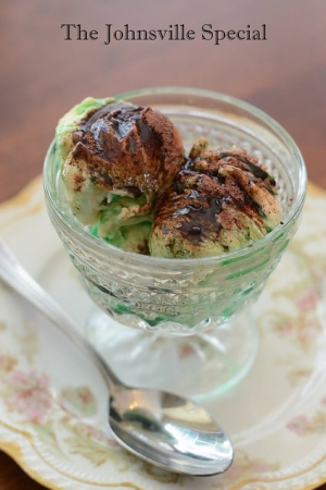 A glass dish filled with ice cream, creme de menthe, and sprinkled with ovaltine.