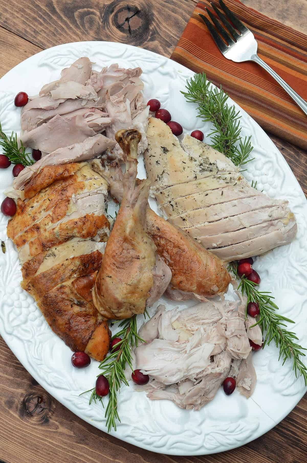 A wonderful, buttery, herb seasoning rub helps to create this tender, juicy Herb Roasted Turkey. The perfect centerpiece for your holiday table!