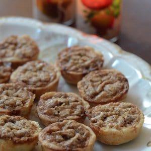 A plate of pecan tarts.