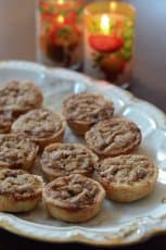 Pecan tarts on a plate.