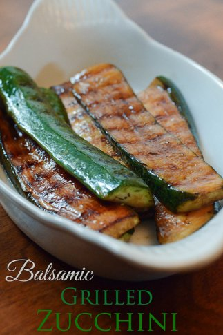 Slices of grilled zucchini in a small white dish.
