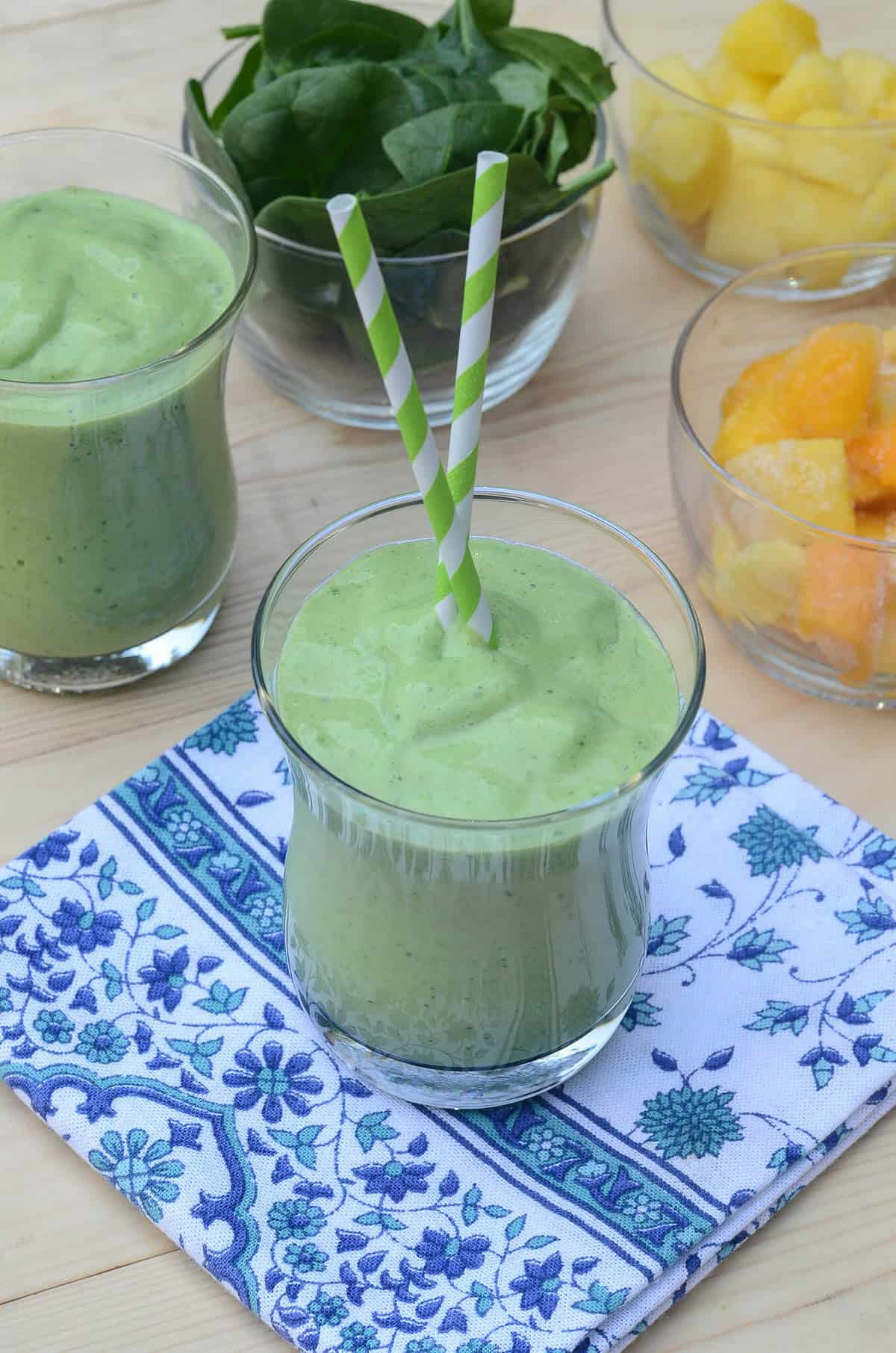 Packed with nutrition and incredible flavor, this creamy Tropical Green Smoothie is a delicious way to start the day!