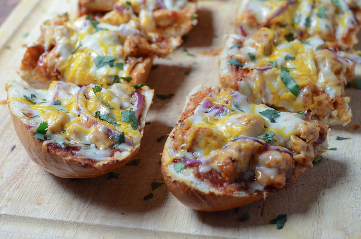 BBQ Chicken French Bread Pizza sliced on a cutting board.