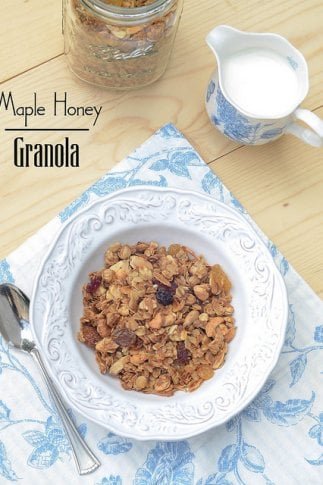 A bowl of granola on a blue and white towel.
