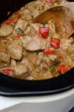 Slow Cooker Caribbean Pork just after the cooking time being stirred with a wooden spoon.