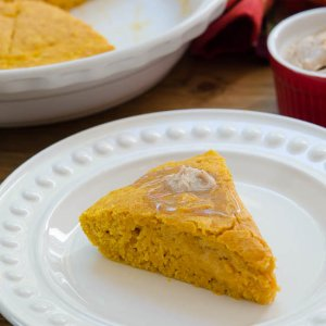 A slice of Pumpkin Cornbread on a white plate.