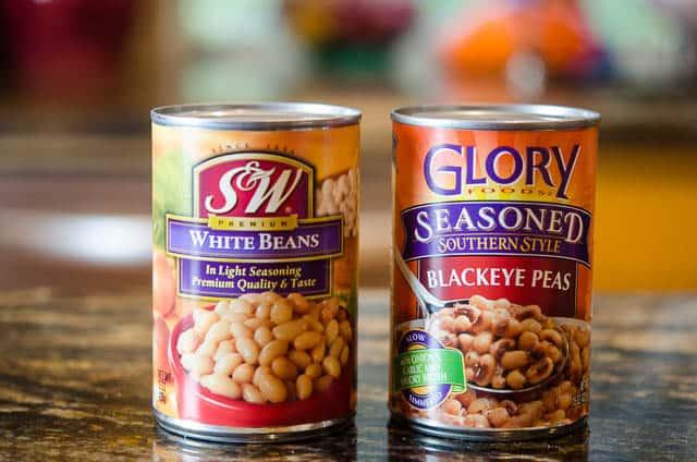 A can of S&W White Beans and Glory Seasoned Blackeye Peas.