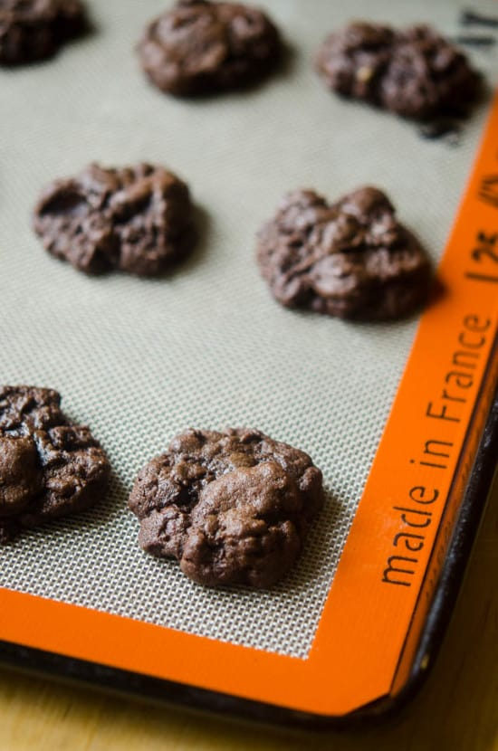 Double Chocolate Cookies on a silpat mat after they come out of the oven.