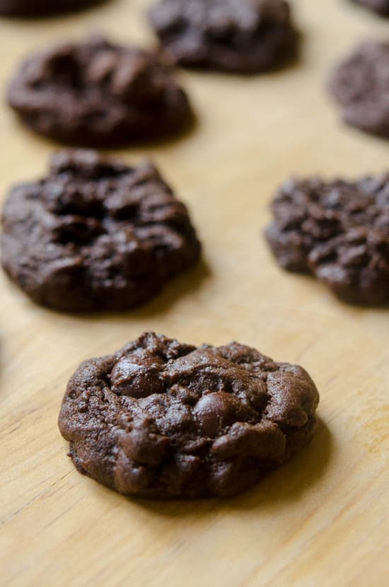 Double Chocolate Cookies on a wood cutting board.
