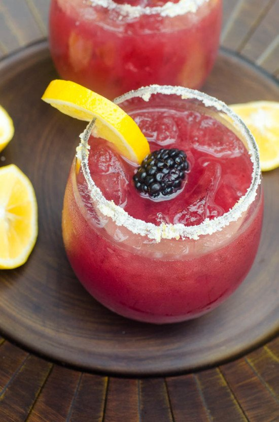 These festive, refreshing Blackberry Lemonade Margaritas include fresh blackberry puree, lemonade, and tequila. Tart, lightly sweet, and delicious. A great warm weather party drink!