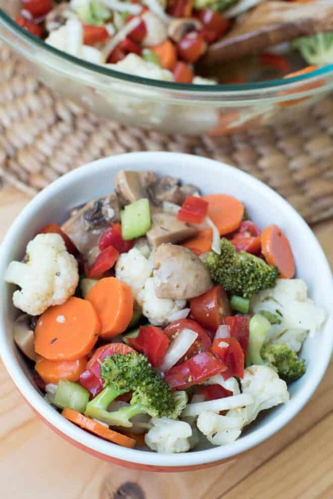 A small bowl full of Marinated Vegetable Salad.