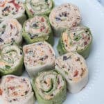 Green and white pinwheels on a white plate.