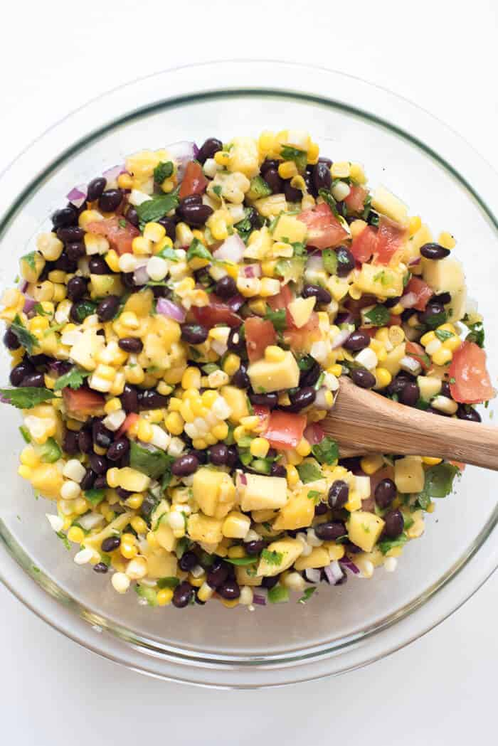 Fresh ingredients combine to create this colorful, summery Mango Corn Salsa with Black Beans that is as bright and pretty as a sunny day!