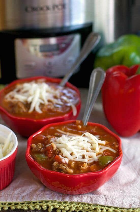 Slow Cooker Stuffed Pepper Soup in red bowls.