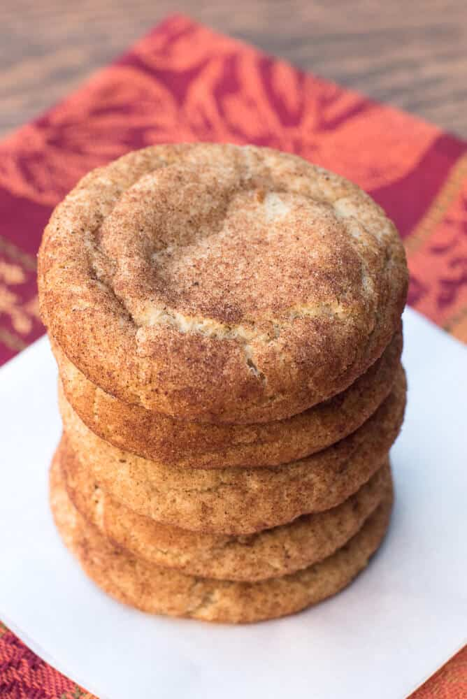 Pumpkin Spice Snickerdoodles stacked on a white plate.
