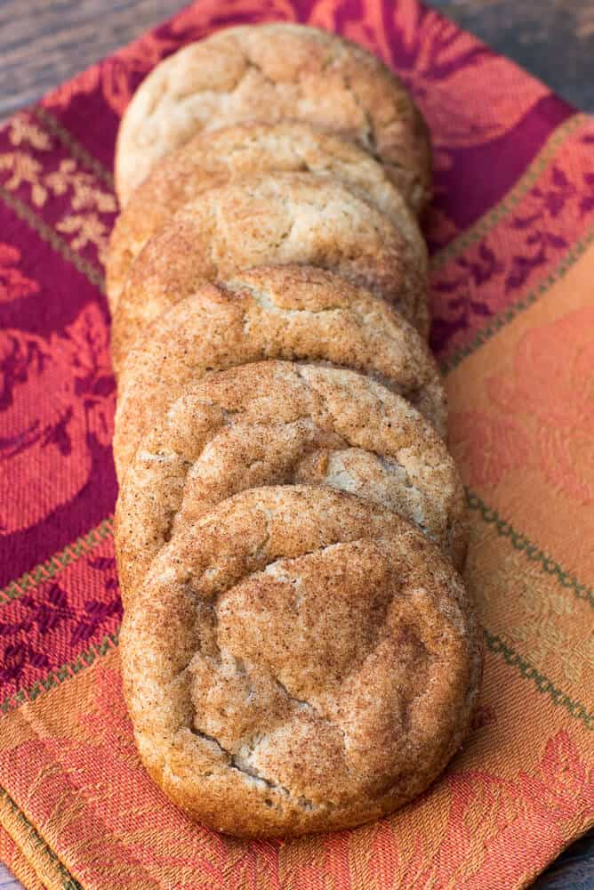 Pumpkin Spice Snickerdoodles on a pretty fall patterned cloth.