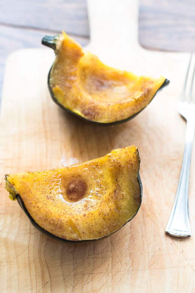 Sweet Baked Acorn Squash on a cutting board.