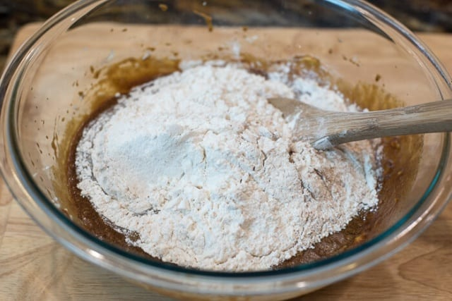 Adding the dry mixture to the gingerbread cake batter.