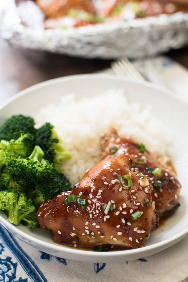 Baked Chicken Teriyaki in a white serving bowl with steamed broccoli and white rice.