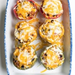 Colorful bell peppers stuffed with a meat filling and topped with melted cheese.