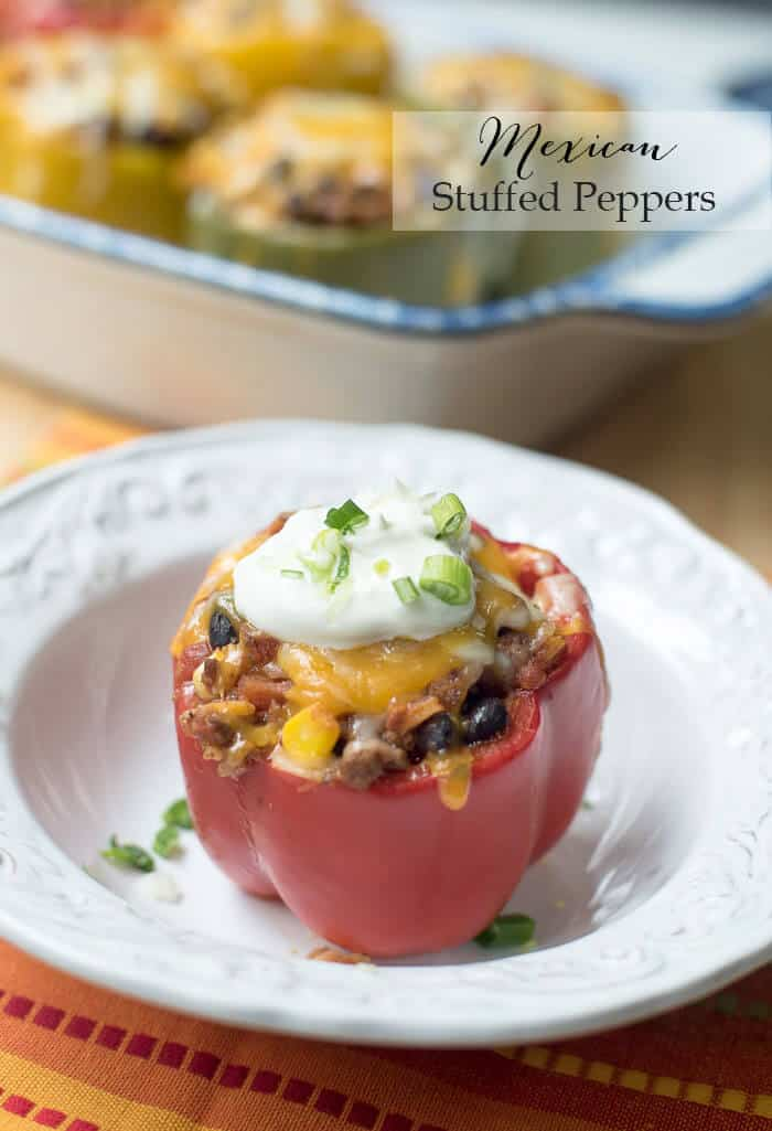 A delicious filling made with seasoned ground beef, rice, black beans, and corn is topped with cheese and baked inside pretty colored bell peppers. Mexican Stuffed Peppers are a vibrant, super tasty meal.