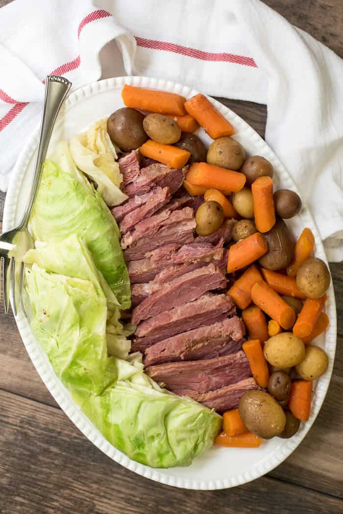 Slow Cooker Cooker Corned Beef and Cabbage - on a serving platter.