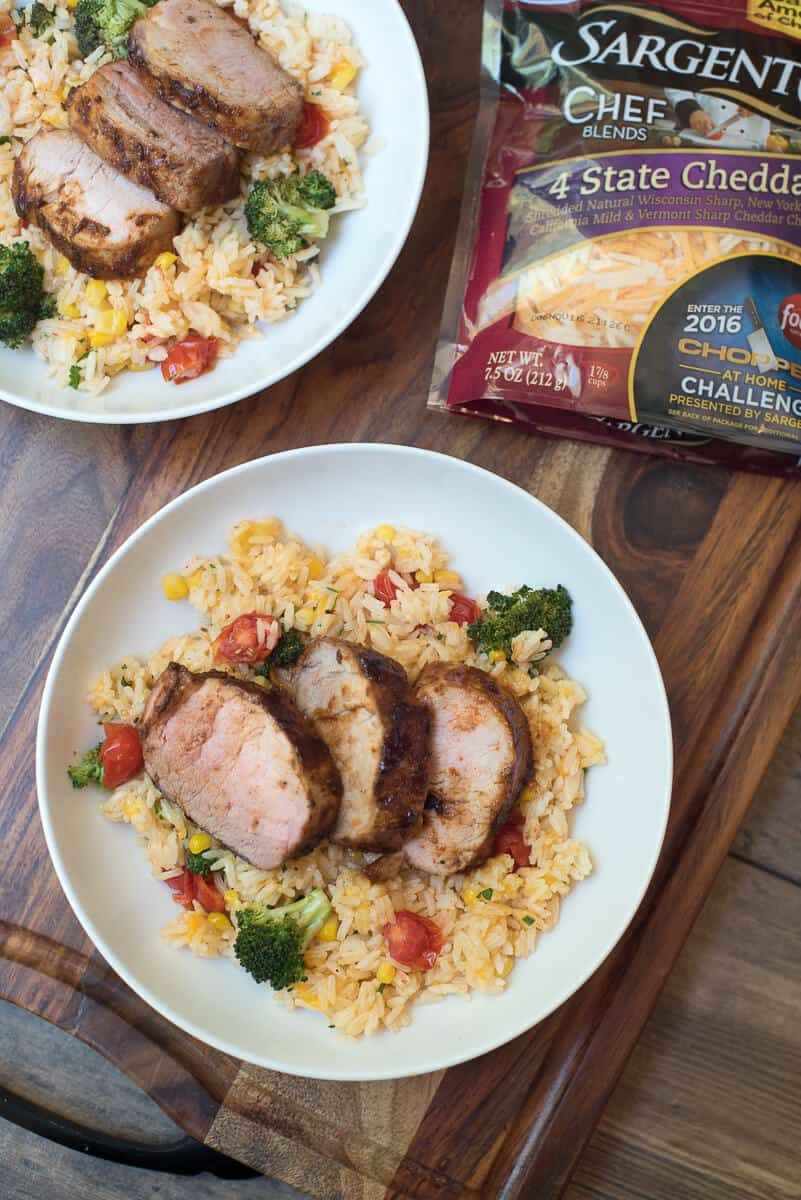 Grilled Pork Tenderloin with Cheesy Vegetable Rice is a hearty, comforting meal that is sure to please the entire family. Summer comfort food at it's best!