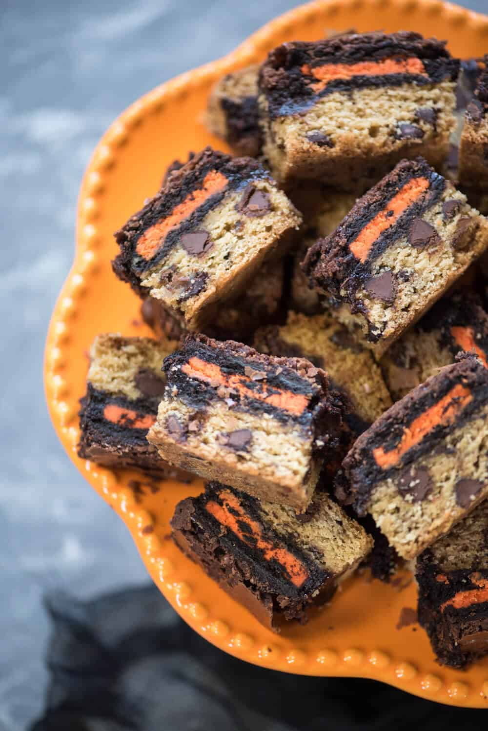 A close up image of Halloween Oreo Brookie Bars on an orange platter.