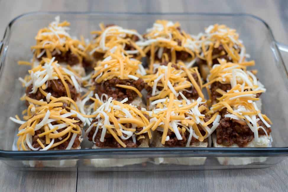 The sloppy joe mixture is topped with shredded cheese.