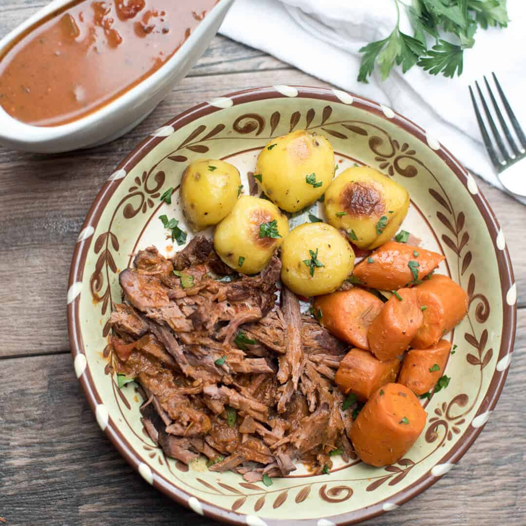 Slow cooked in a luscious tomato based sauce with carrots, this Slow Cooker Italian Pot Roast makes a fabulous meal for any night of the week!